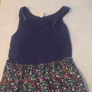 Medium knee length floral and navy dress.